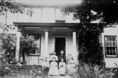 Family on House Steps